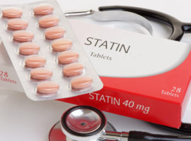 statin tablets on top of a stethoscope